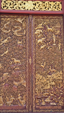 Door wood carving in temple, Thailand