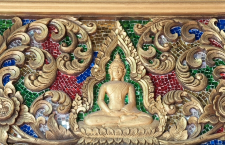 Native Thai style wood carving in the temple