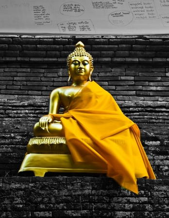 Golden buddha statue in Thailand in black and white background