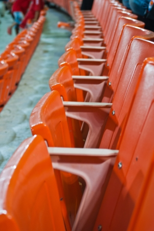 regular red seats in a stadium Stock Photo - 14351360
