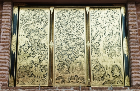 Ancient Golden carving window of Thai temple photo