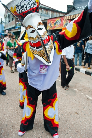 LOEI PROVINCE,THAILAND-July 23, 2012.: Ghost Festival (Phi Ta Khon) is a type of masked procession celebrated on Buddhist merit- making holiday known in Thai as