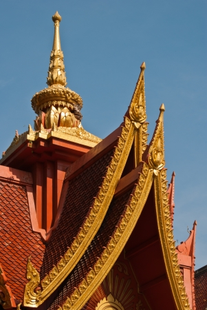 Detail of Thai temple roof with clear sky. photo