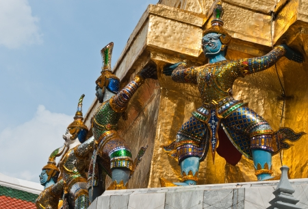 Giants sculpture standing in front of Pagoda in The Royal Grand Palace, Bangkok, Thailand photo