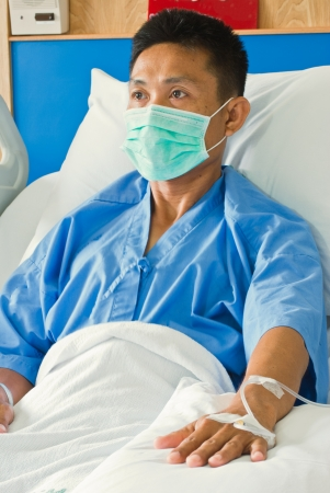 a patient with saline intravenous  iv  on hospital bed Stock Photo - 14798431
