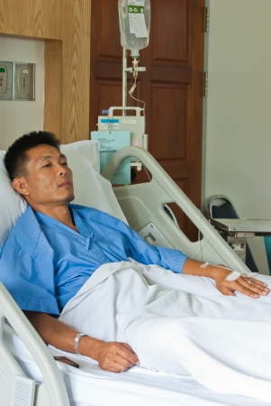 a patient with saline intravenous  iv  on hospital bed Stock Photo - 14798428