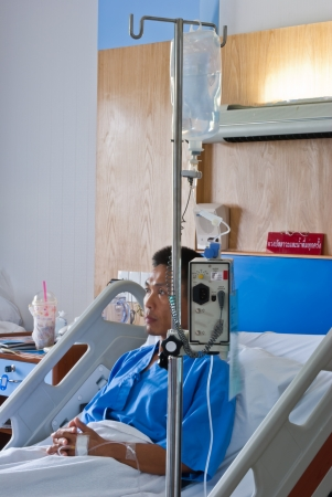 a patient with saline intravenous  iv  on hospital bed