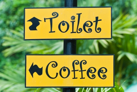 The signs of coffee shop and toilet in the park.