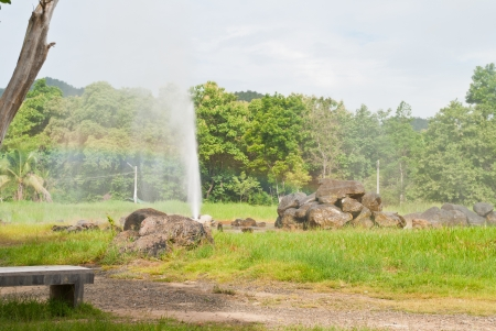 Geyser with rainbow and forest  Stock Photo - 15515970