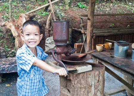 little boy withVintage coffee mill grinder Stock Photo - 15275960