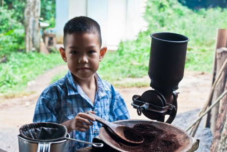 little boy withVintage coffee mill grinder Stock Photo - 15275959