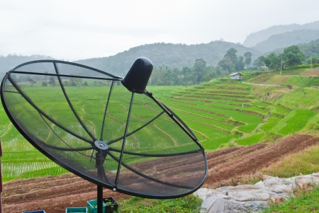 Satellite dish with rice fields and mountain scenery Stock Photo - 15515964