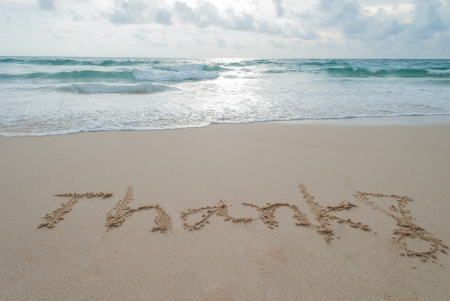 The Word thank Written in the Sand on a Beach at Phuket island,Thailand