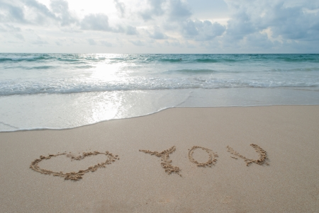 The Word love you Written in the Sand on a Beach at Phuket island,Thailand Stock Photo - 18936635