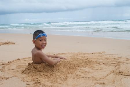 playful boy on the beach with sea  on background at Phuket island,Thailand