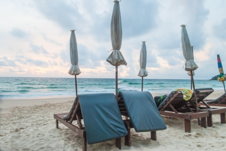 Chairs and umbrella on  tropical beach at Phuket island,Thailand Stock Photo