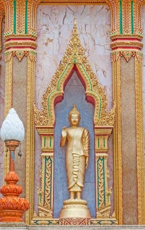 Golden Buddha  statue in the church at Wat Chalong  Phuket island,Thailand