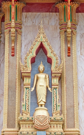 Golden Buddha  statue in the church at Wat Chalong  Phuket island,Thailand photo