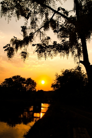 Silhouette Sunset over Canal, Chiang Mai, Thailand