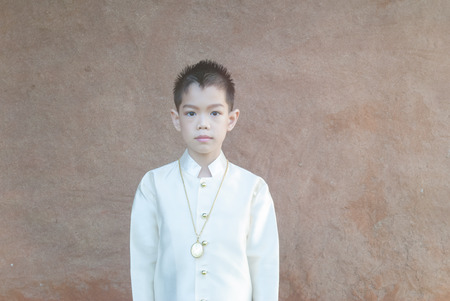 asian boy wearing national dress.