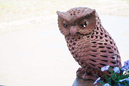 Owl made by brown clay