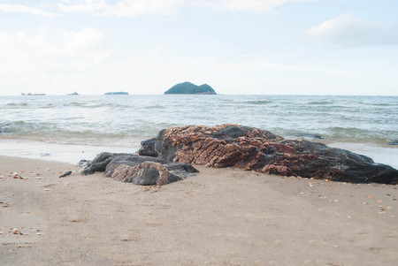 Black rocks formed by water and waves erosion, located on Samila Beach Songkhla, Thailand