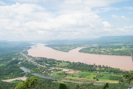 Top view Mekong river with mountain and cloudy sky and tree from NongKai,Thailand Stock Photo