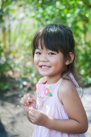 Close up portrait of a beautiful smiling little girl