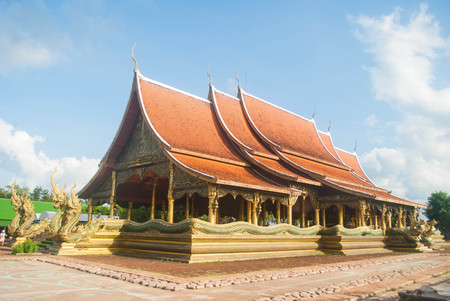 Beautiful Buddhist temple on  bright sky  in the Ubon Ratchathani ,Thailand, Stock Photo