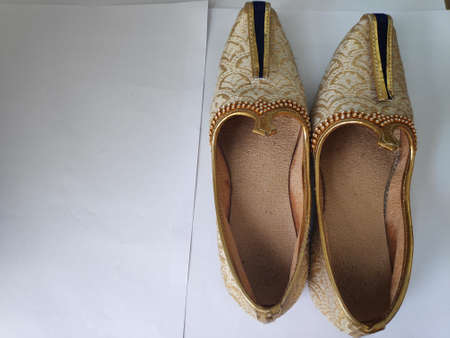 A pair of Juti an indian enthetic wearable product.These are essential wear during events, festivals and weddings.