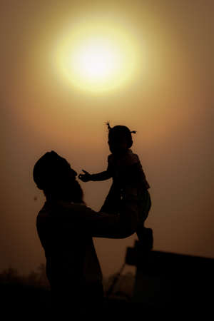 Silhouette of father and child playing Reklamní fotografie