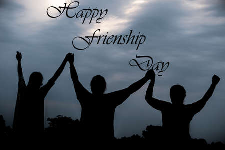 silhouette of friends with hands up (Happy friendship Day)