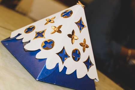 A closeup of a chocolate box present