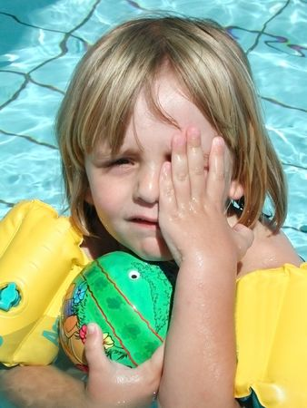 drop out: Little boy is playing in the pool Stock Photo