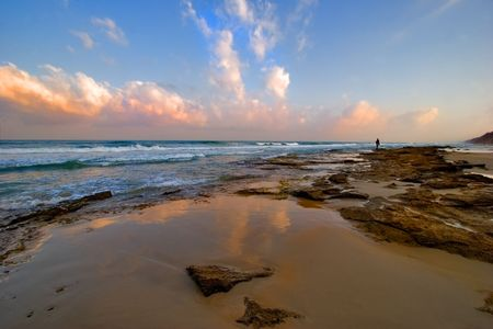 A man standing on a sea shore Stock Photo - 555013