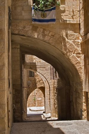 Street in antient Jerusalem, lit by sun      photo