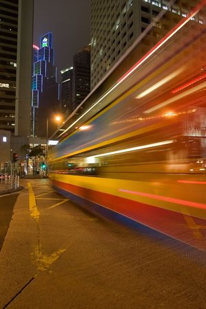 Night bus lit by advertisement lights on Hong-Kong street   Stock Photo - 695010