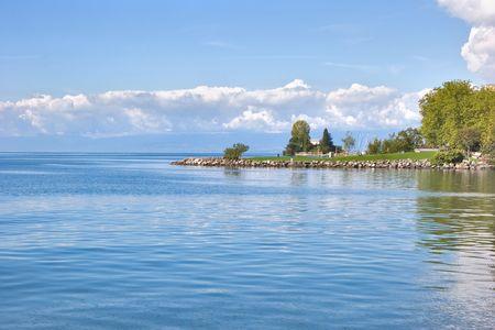 Green cape on lake Leman in Switzerland. photo