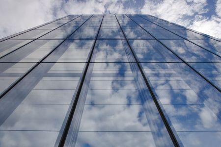 A mirror wall of a skyscraper in resort city Montreux in Switzerland photo