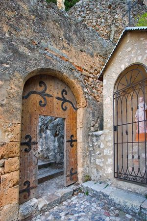 Ancient door, steps leaders in church, and the madonna photo