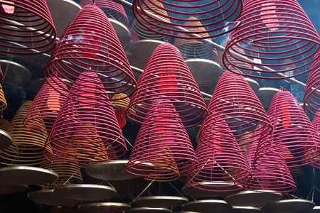 godliness:  Cones � incense burners, hooked from a ceiling of a Chinese temple  Stock Photo