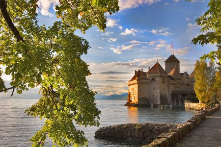 A medieval fortress ?hillon on lake Leman on a sunset