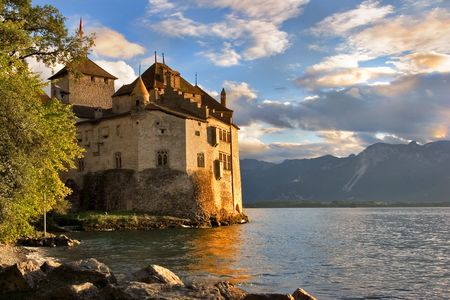 leman: A medieval fortress ?hillon on lake Leman on a sunset