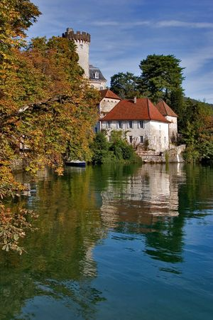 Middle-aged castle on a lake Annecy bank on a bright day   photo