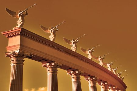 A row of roman winged goddesses with trumpets on a stand     photo
