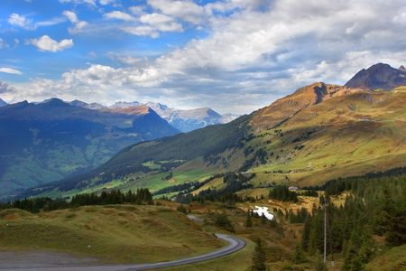 Narrow road highly in the Swiss Alpes   photo