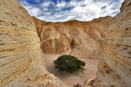Ancient mountains near to an oasis Ein-Bokek at coast of the Dead Sea Stock Photo