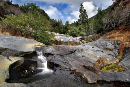 A drying stone watercourse of mountain river in Sequoyah national park, California  photo