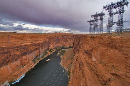 rapid steel:  An abrupt bend of the river Colorado and metal support with electricity cables in state of Utah in the USA