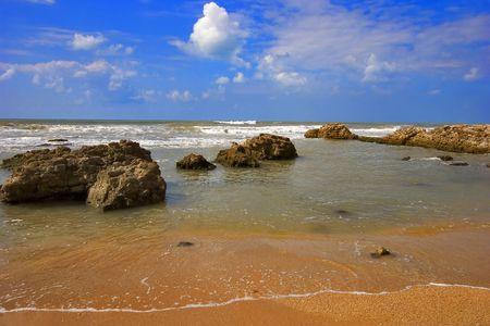 Coast of Mediterranean sea with big stones in water